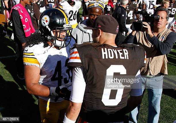 Brian Hoyer of the Cleveland Browns is greeted by Troy Polamalu of the Pittsburgh Steelers after Cleveland's 3110 win at FirstEnergy Stadium on...