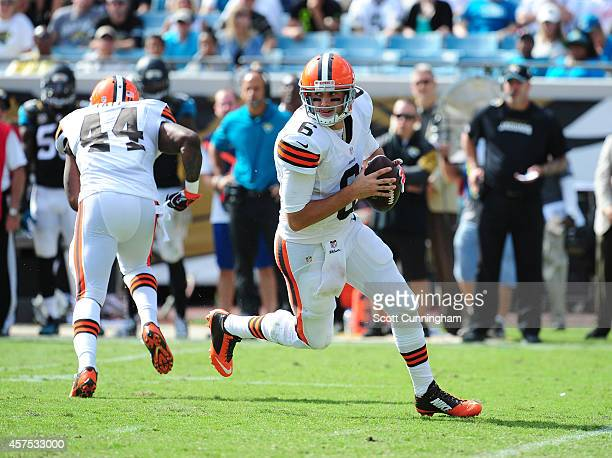 Brian Hoyer of the Cleveland Browns rolls out to pass against the Jacksonville Jaguars at EverBank Field on October 19 2014 in Jacksonville Florida