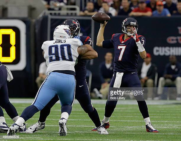 Brian Hoyer of the Houston Texans looks for a receiver as he gets a block from Duane Brown on DaQuan Jones of the Tennessee Titans at NRG Stadium on...
