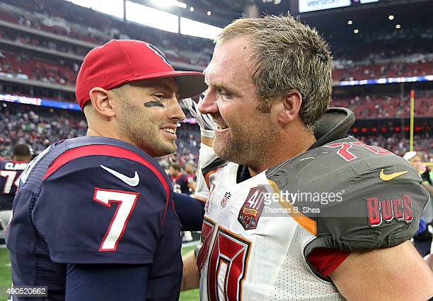 Brian Hoyer of the Houston Texans meets Logan Mankins of the Tampa Bay Buccaneers after the game on September 27, 2015 at NRG Stadium in Houston,...