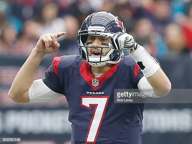 Brian Hoyer of the Houston Texans signals against the Jacksonville Jaguars in the first quarter on January 3 2016 at NRG Stadium in Houston Texas