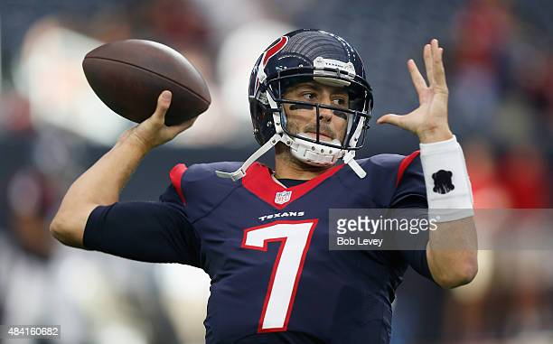Brian Hoyer of the Houston Texans throws a pass during warmups before a preseason game against the San Francisco 49ers at Reliant Arena at Reliant...