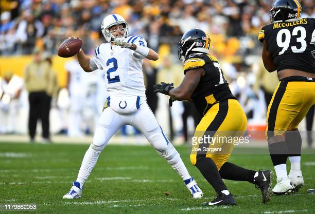 Brian Hoyer of the Indianapolis Colts makes a pass in front of Javon Hargrave of the Pittsburgh Steelers during the fourth quarter at Heinz Field on...