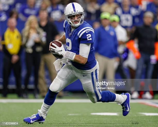 Brian Hoyer of the Indianapolis Colts rolls out of the pocket to pass during the game against the Miami Dolphins at Lucas Oil Stadium on November 10...