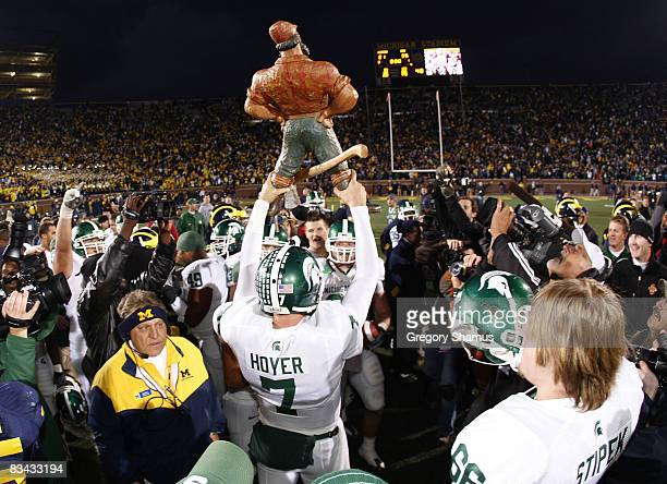 Brian Hoyer of the Michigan State Spartans holds up the Paul Bunyan trophy after beating the Michigan Wolverines 3521 on October 25 2008 at Michigan...