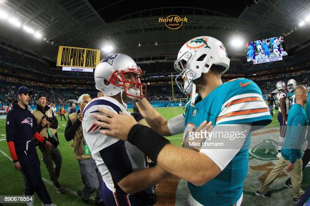Brian Hoyer of the New England Patriots congratulates Jay Cutler of the Miami Dolphins on their 27 to 20 win at Hard Rock Stadium on December 11 2017...