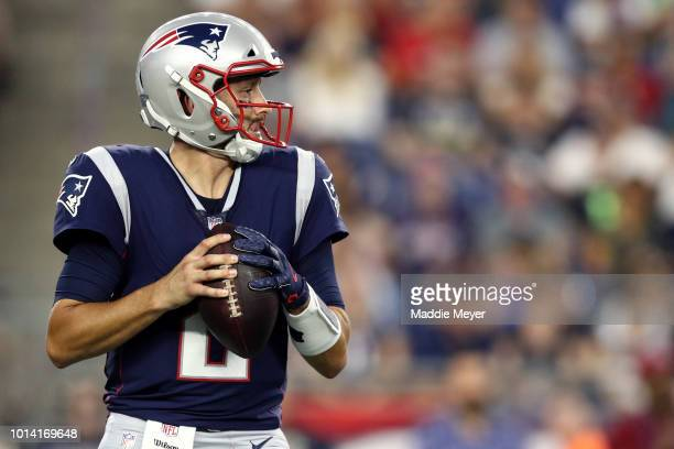 Brian Hoyer of the New England Patriots looks for a pass during the preseason game between the New England Patriots and the Washington Redskins at...