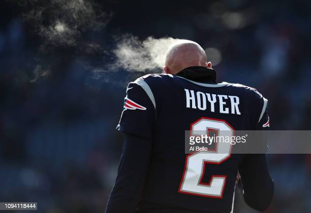 Brian Hoyer of the New England Patriots looks on during warmups against the Los Angeles Chargers during their AFC Divisional Round playoff game at...