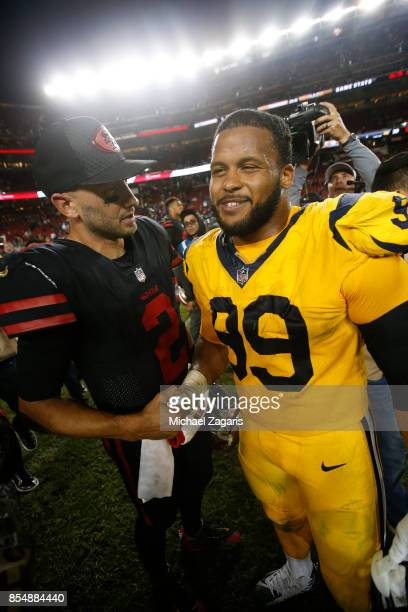 Brian Hoyer of the San Francisco 49ers and Aaron Donald of the Los Angeles Rams talk on the field following the game at Levi's Stadium on September...