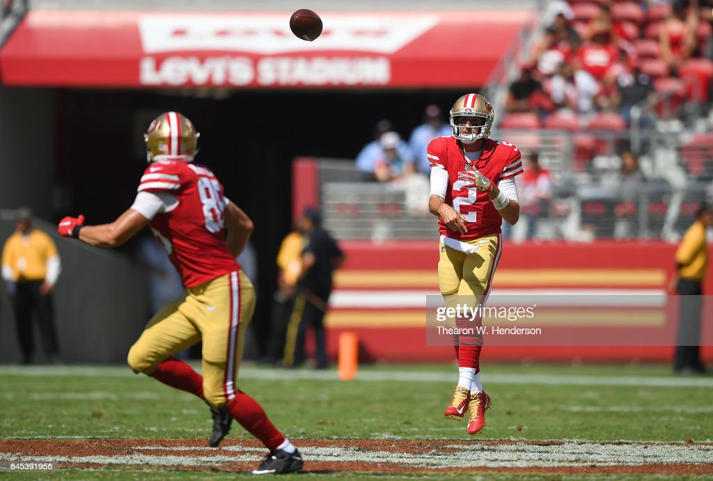 Brian Hoyer #2 of the San Francisco 49ers throws a pass to George Kittle #85 against the Carolina Panthers during the second quarter of their NFL football game at Levi's Stadium on September 10, 2017 in Santa Clara, California.
