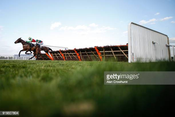 Brian Hughes riding Le Patriote clear the last to win The Ascot Spring Garden Show Handicap Hurdle Race at Ascot Racecourse on February 17 2018 in...