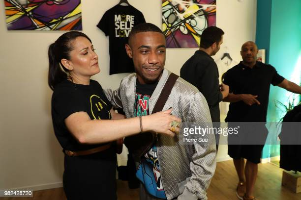 Brian Igel Stacy Igel Kareem Burke jr and Kareem Burke attend the Boy Meets Girl Black Label X Smiley Original as part of Paris Fashion Week on June...
