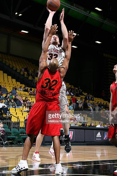 Brian Jackson of the Utah Flash puts the shot up over Randy Livingston of the Idaho Stampede on March 13, 2008 at the David O. McKay Events Center in...