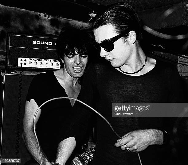 Brian James and Dave Vanian of English punk band The Damned perform on stage at the Hope and Anchor pub, Islington, London, England, during summer...
