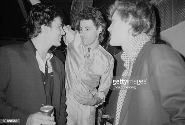 Brian James Bob Geldof and Stewart Copeland at a roller skating rink in Queensway Bayswater London 1980