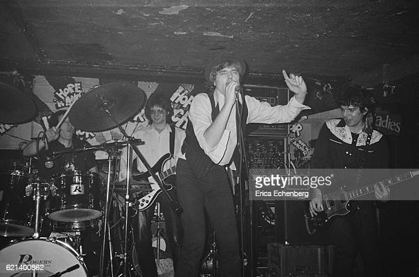 Brian James performs on stage with the Severed Dwarfs Hope and Anchor London 1981 LR Rod Latter Chris Sol Alan Lee Shaw Brian James