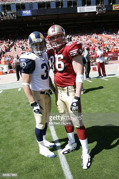 Brian Jennings of the San Francisco 49ers meets with Adam Archuleta of the St Louis Rams at Monster Park on September 11 2005 in San Francisco...