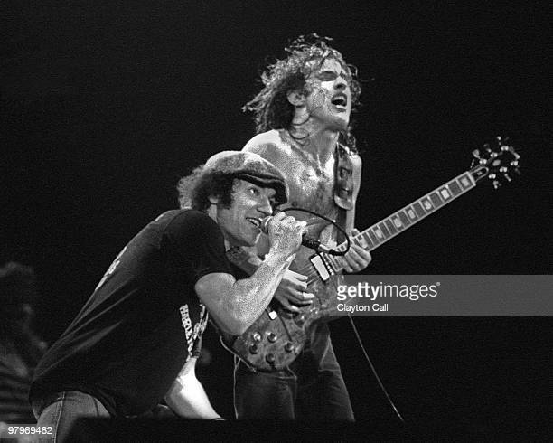 Brian Johnson and Angus Young from AC/DC perform live on stage at the Cow Palace in San Francisco on February 16 1982