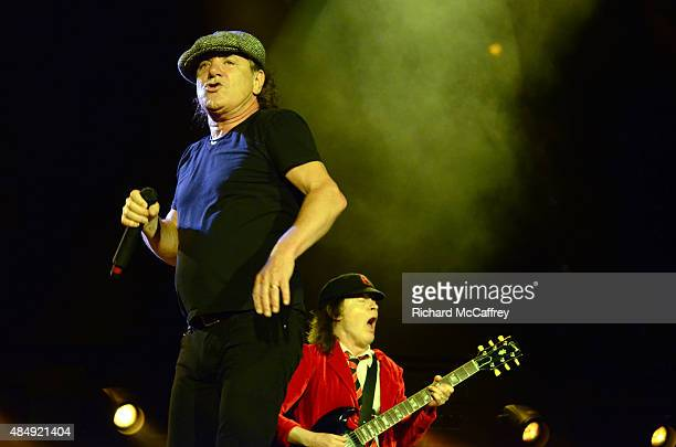 Brian Johnson and Angus Young of AC/DC perform at Gillette Stadium on August 22 2015 in Foxboro Massachusetts