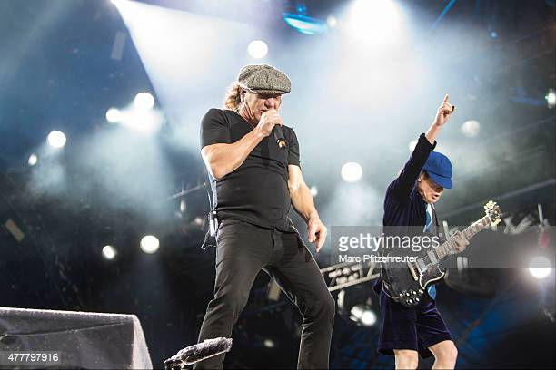 Brian Johnson and Angus Young of AC/DC perform onstage during their 'Rock Or Bust World Tour' at the Jahnwiesen on June 19 2015 in Cologne Germany