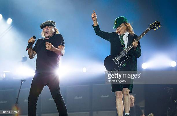 Brian Johnson and Angus Young of AC/DC performs on stage during their 'Rock or Bust' World Tour at Ford Field on September 8 2015 in Detroit Michigan