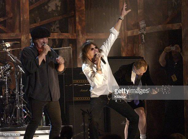 Brian Johnson and Angus Young of AC/DC with Steven Tyler