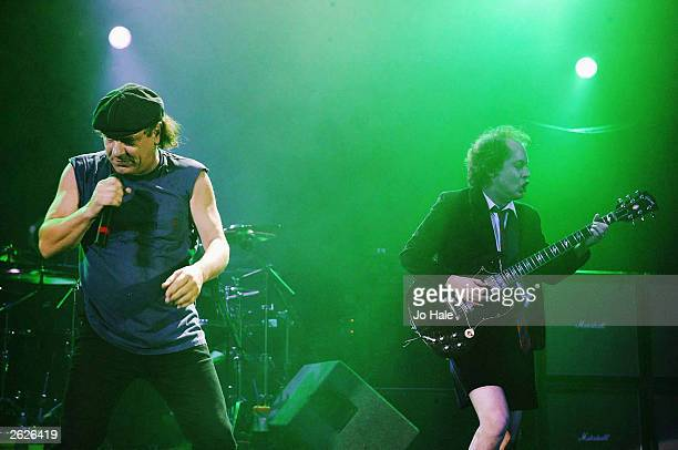 Brian Johnson and Angus Young of Australian Rock group AC/DC perform live on stage at the Hammersmith Apollo on October 21 2003 in London