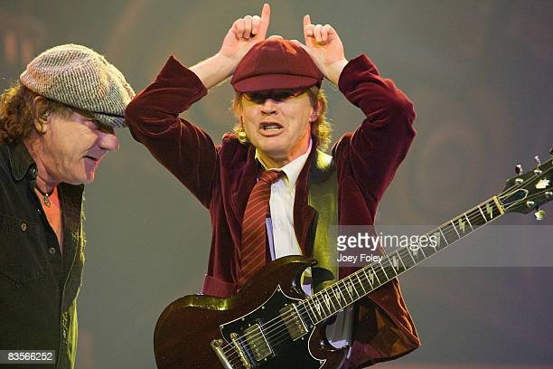 Brian Johnson and Angus Young of the Australian rock band AC/DC perform in concert on their 'Black Ice World Tour' at the Conseco Fieldhouse on...
