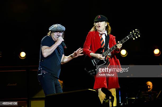 "Brian Johnson and Angus Young perform onstage during their ""Rock or Bust"" World Tour at MetLife Stadium on August 26, 2015 in East Rutherford City."