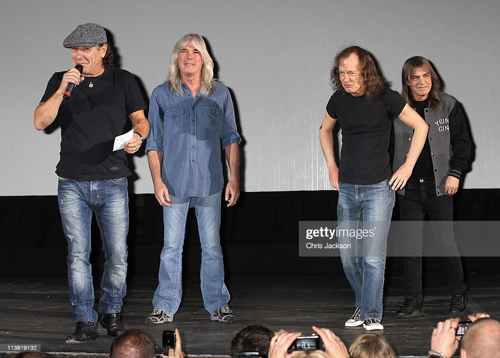 Brian Johnson, Cliff Williams, Angus Young and Malcolm Young of AC/DC are on stage at HMV Hammersmith for the World Premiere of 'AC/DC Live at River Plate' Presented by DeLeón Tequila on May 6, 2011 in London, England.