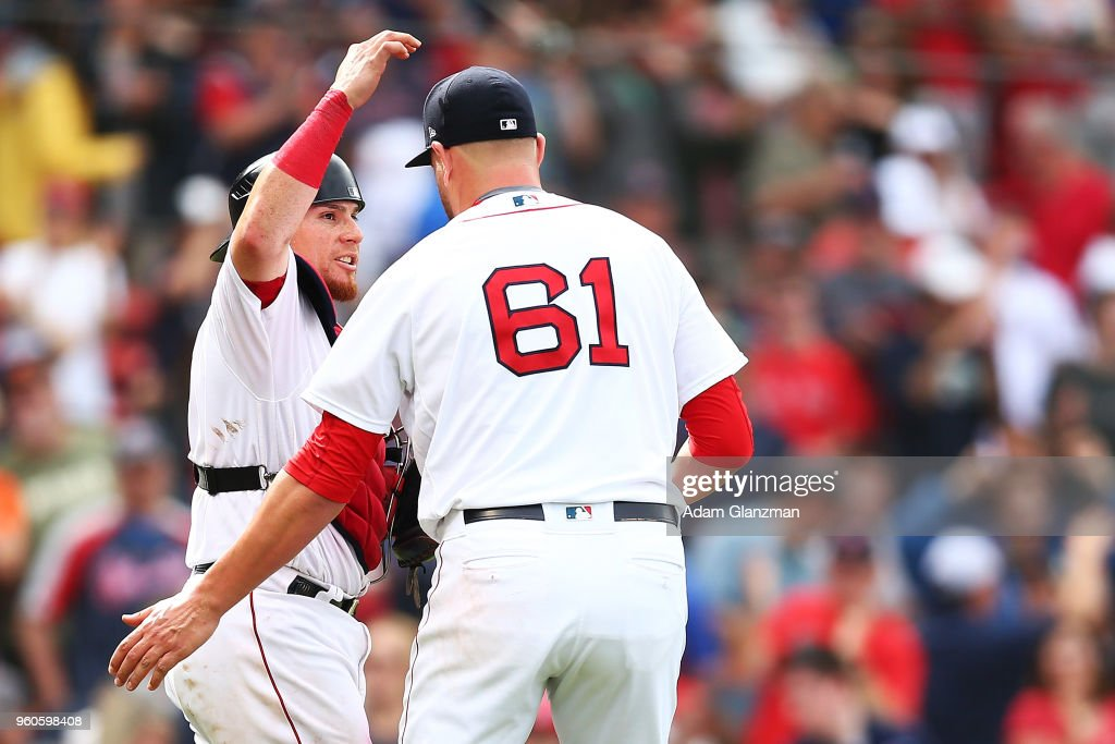 Brian Johnson #61 of the Boston Red Sox embraces Christian Vazquez #7 after a victory over the Baltimore Orioles at Fenway Park on May 20, 2018 in Boston, Massachusetts.