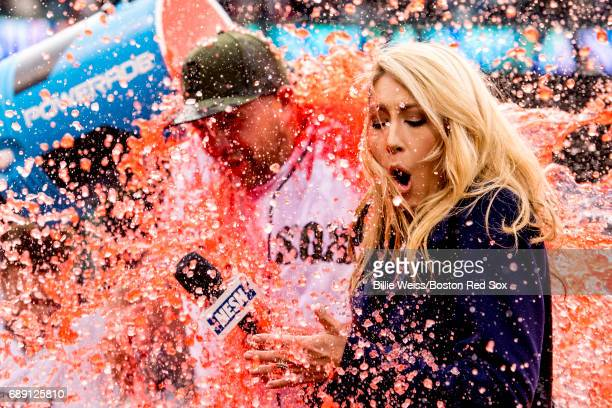 Brian Johnson of the Boston Red Sox is doused with Powerade alongside NESN anchor Guerin Austin after pitching a complete game against the Seattle...