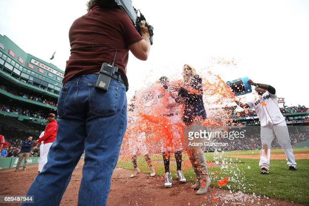 Brian Johnson of the Boston Red Sox is showered with Powerade while being interviewed by NESN sideline reporter Guerin Austin after the victory over...