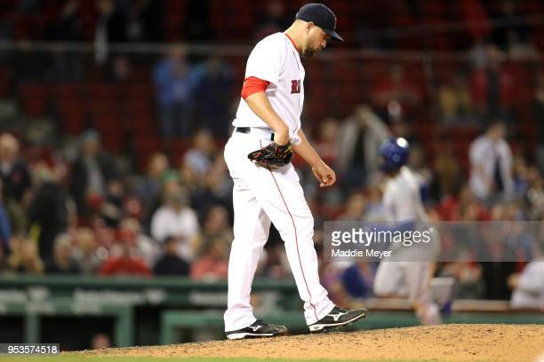 Brian Johnson of the Boston Red Sox reacts after Jorge Soler of the Kansas City Royals hit a three run home run during the thirteenth inning at...