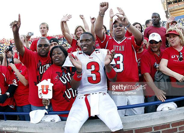 Brian Johnson of the Utah Utes celebrates with fans after beating the Michigan Wolverines 25-23 on August 30, 2008 at Michigan Stadium in Ann Arbor,...