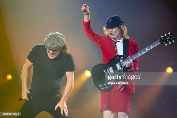 Brian Johnson singer and Angus Young guitarist of the Australian rock band AC/DC play with their band in the Veltins Arena Gelsenkirchen Germany 12...