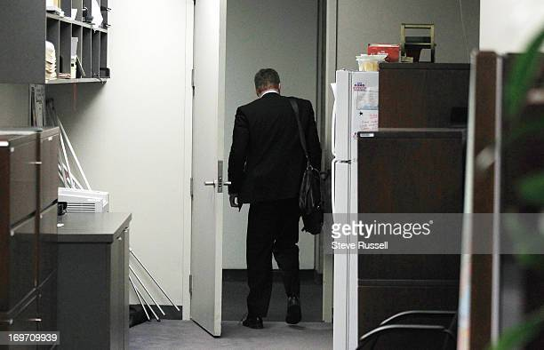 Brian Johnston leaves the fish bowl of mayoral staff offices after becoming the latest casualty of the Mayor Rob Ford scandal at City Hall in Toronto...