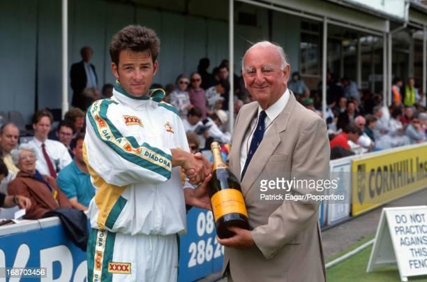 "Brian Johnston presents Mark Waugh with a magnum of Veuve Clicquot Champagne for the ""champagne moment"", 5th Test England v Australia Edgbaston..."