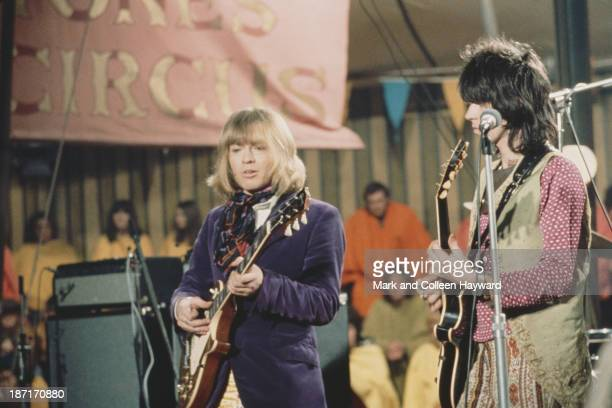 Brian Jones and Keith Richards from The Rolling Stones perform live on stage on the set of the Rolling Stones Rock and Roll Circus at Intertel TV...