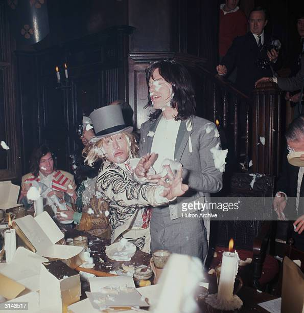 Brian Jones and Mick Jagger of the British rock group The Rolling Stones enjoying a food fight at the Kensington Gore Hotel where the band staged a...