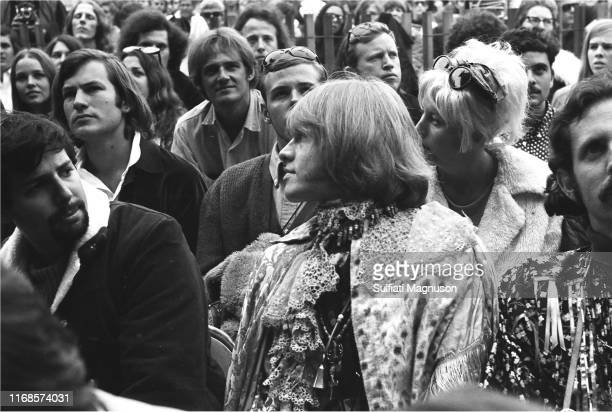 Brian Jones in the Reserved seating section dressed in brocade and lace historical costume surrounded by other musicians and attendees at The...