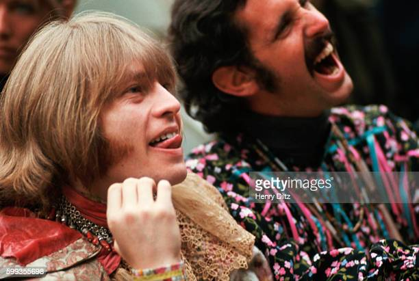 Brian Jones of the Rolling Stones and a fellow audience member enjoy an act at the Monterey Pop Festival in 1967