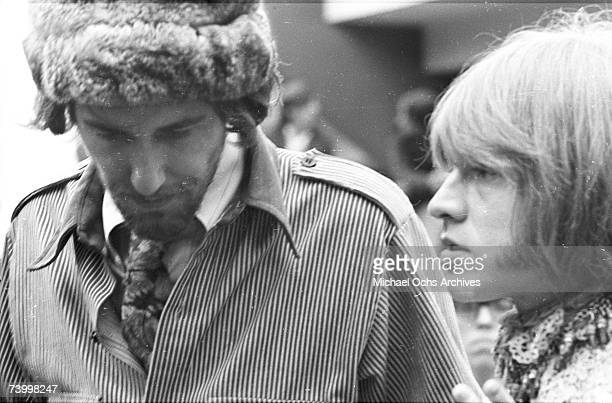 Brian Jones of The Rolling Stones and John Phillips of The Mamas The Papas in the audience at the Monterey Pop Festival on June 18 1967 in Monterey...