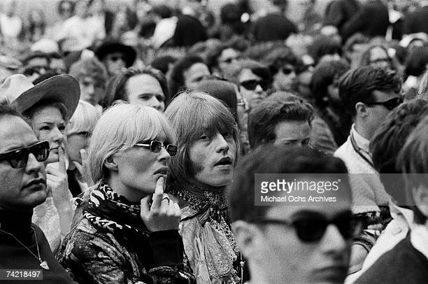 Brian Jones of The Rolling Stones and Nico in the audience at the Monterey Pop Festival on June 18 1967 in Monterey California