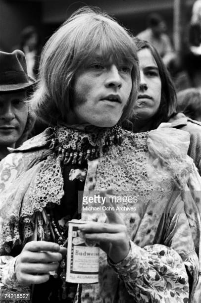 Brian Jones of The Rolling Stones holds a Budweiser can in the audience at the Monterey Pop Festival on June 18 1967 in Monterey, California.