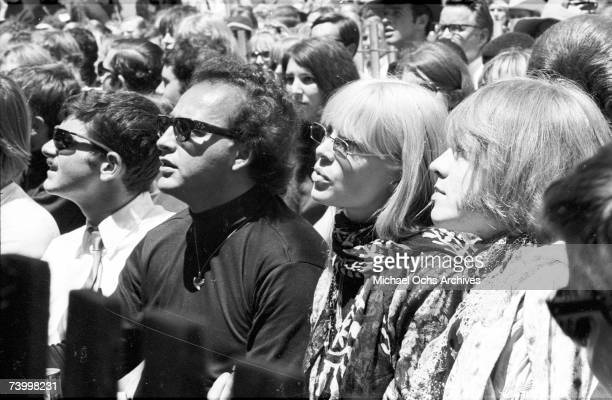 Brian Jones of The Rolling Stones in the audience with Christa Paeffgen at the Monterey Pop Festival on June 18 1967 in Monterey California