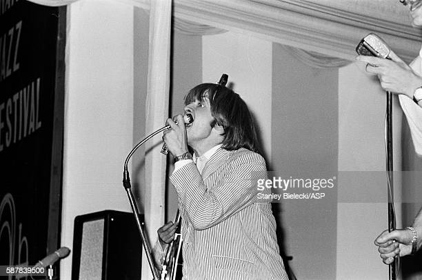 Brian Jones of The Rolling Stones performs on stage playing harmonica at the Fourth National Richmond Jazz Blues Festival United Kingdom 7th August...