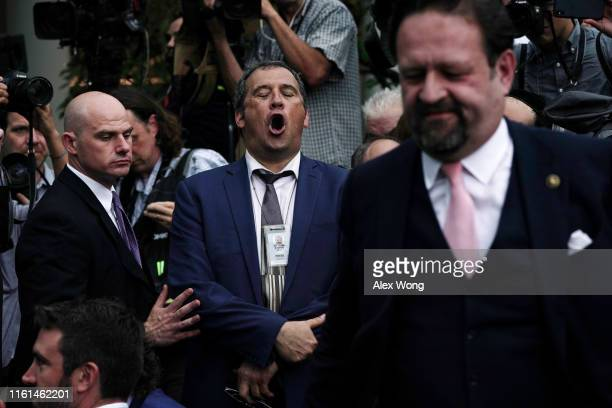 Brian Karem of Playboy Magazine argues with conservative military and intelligence analyst and former deputy assistant to President Donald Trump...