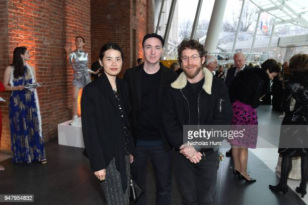 Brian 'KAWS' Donnelly wife Julia Chiang and Dustin Yellin attend the Eighth Annual Brooklyn Artists Ball at The Brooklyn Museum on April 17 2018 in...