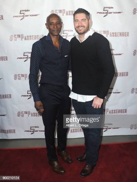 Brian Keith Gamble and Chuck Romero arrive for the cast and crew screening of 5th Passenger held at TCL Chinese 6 Theatres on December 13 2017 in...